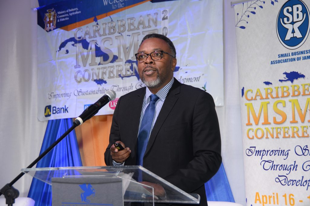 Dwayne Russell, general manager, MC Systems, a member company of The Jamaica National Group addressing Caribbean MSME Conference 2019.